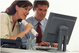 Two people looking at a computer monitor